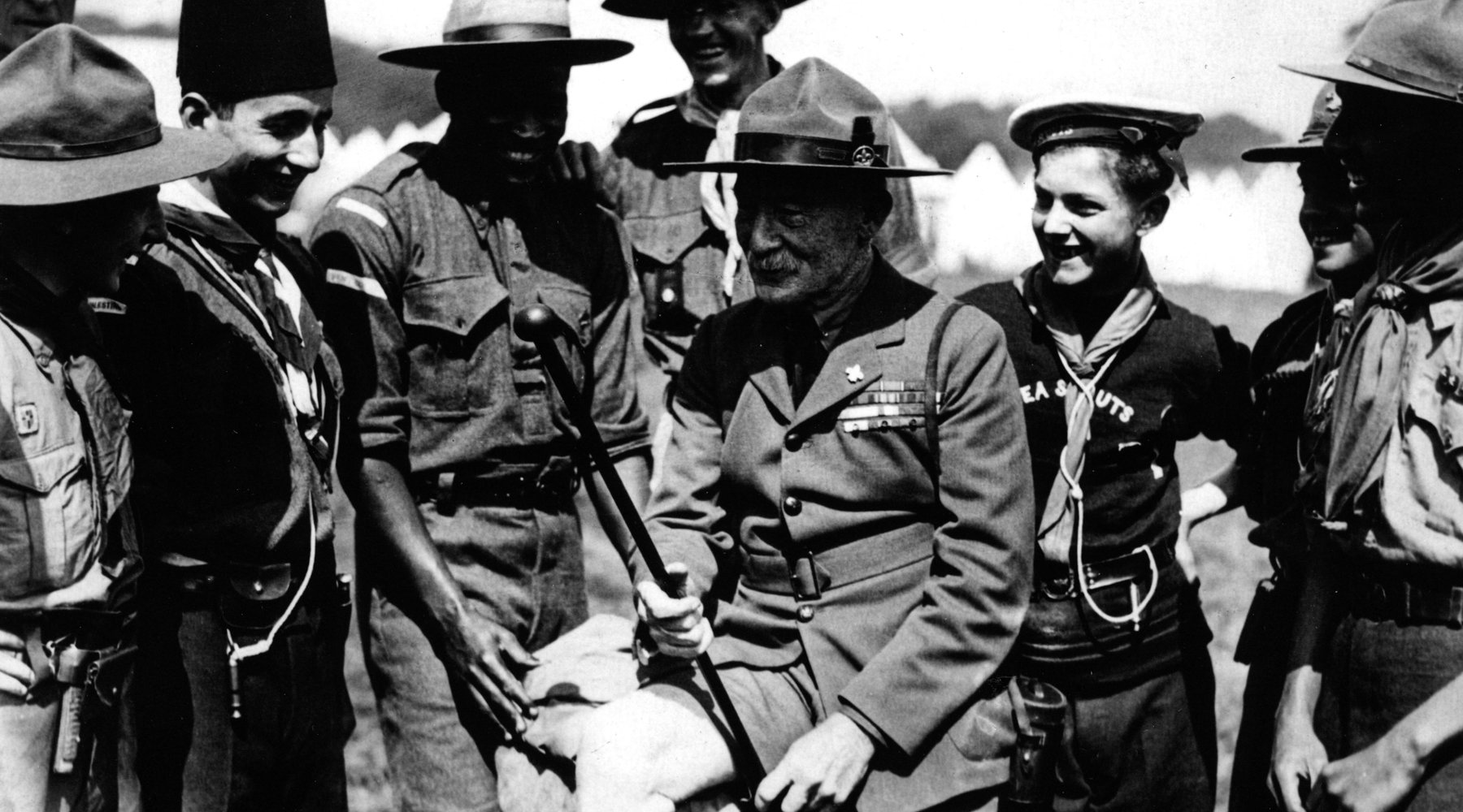 Robert Baden-Powell surrounded by Scouts